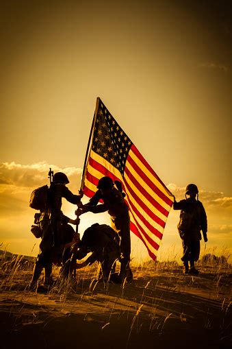 Wwii American Soldiers Raise The Usa Flag Stock Photo
